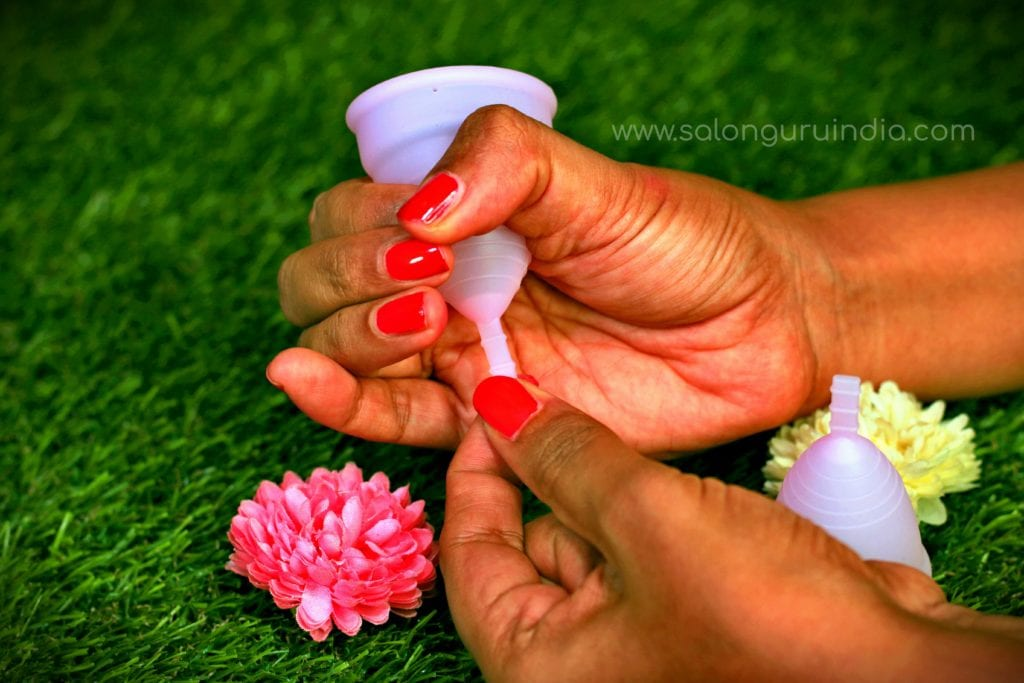 how to wear menstrual cup pull out